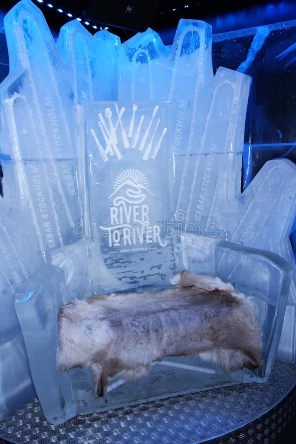At ICEBAR by ICEHOTEL Stockholm, Sweden. ICEBAR by ICEHOTEL Stockholm was built in 2002 as the world`s first permanent ice bar. Every year, interior and design royalty free stock photography