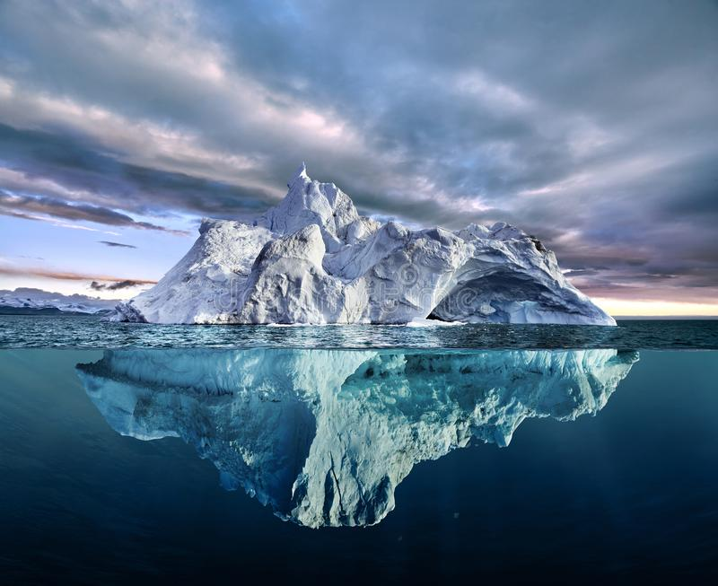 Iceberg with above and underwater view stock image
