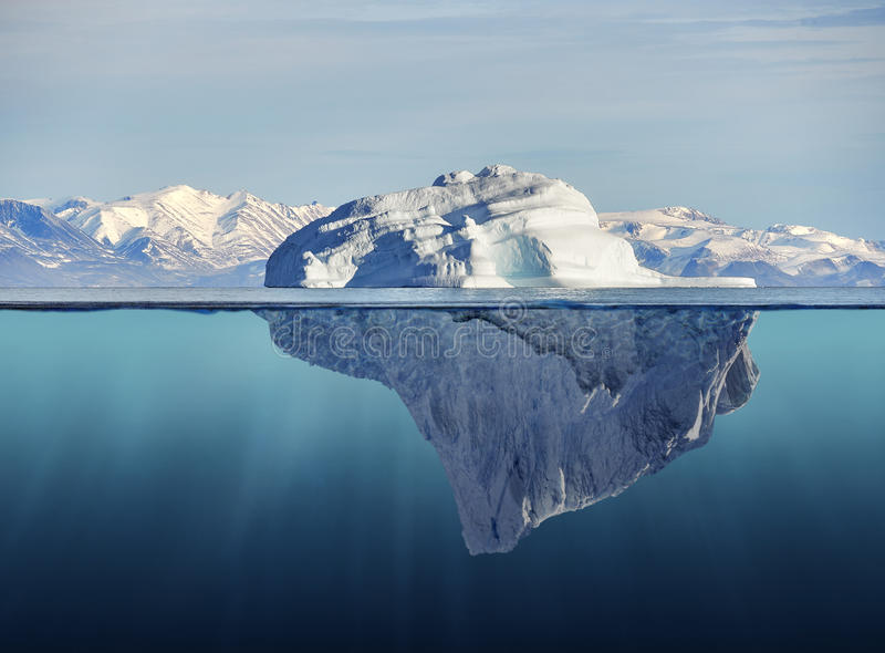 Iceberg with above and underwater view stock images