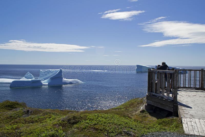 Iceberg Alley Fishing Point St. Anthony NL. Tourist enjoying the beautiful sights that ice-berg alley has to offer royalty free stock images