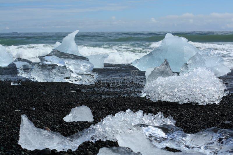 Iceberg on the beach stock photo
