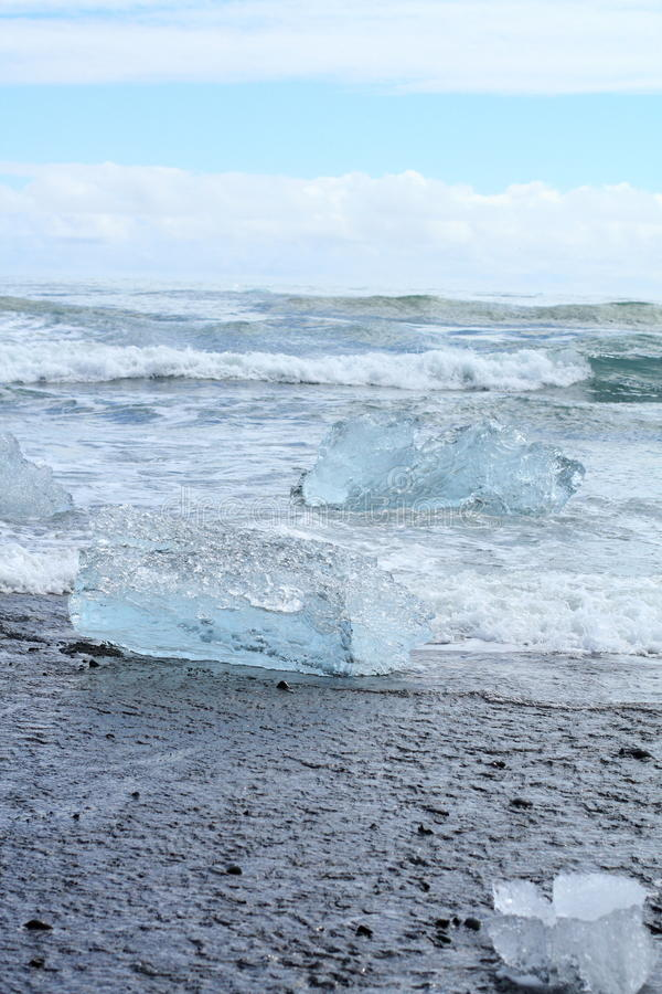 Iceberg on the beach royalty free stock images