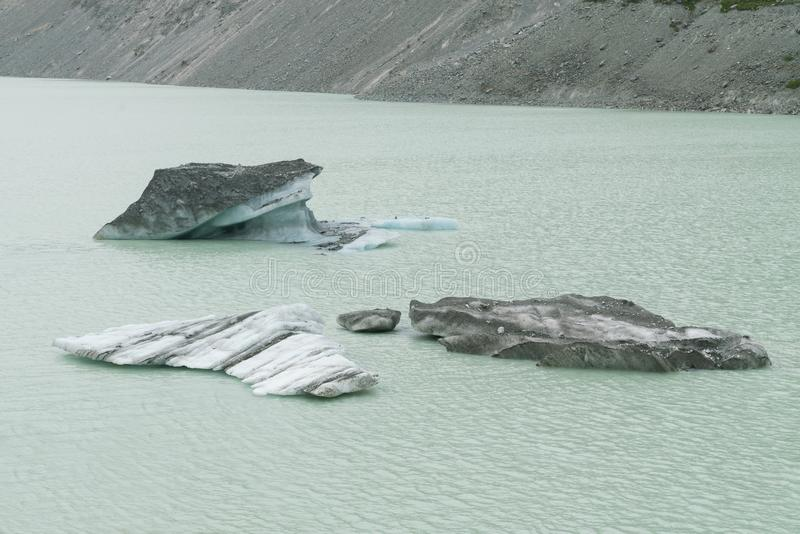 Iceberg breaking from glacier on lake, Fox glacier royalty free stock photos