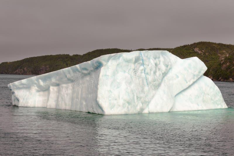 Iceberg in coastal water of Newfoundland NL Canada stock photo