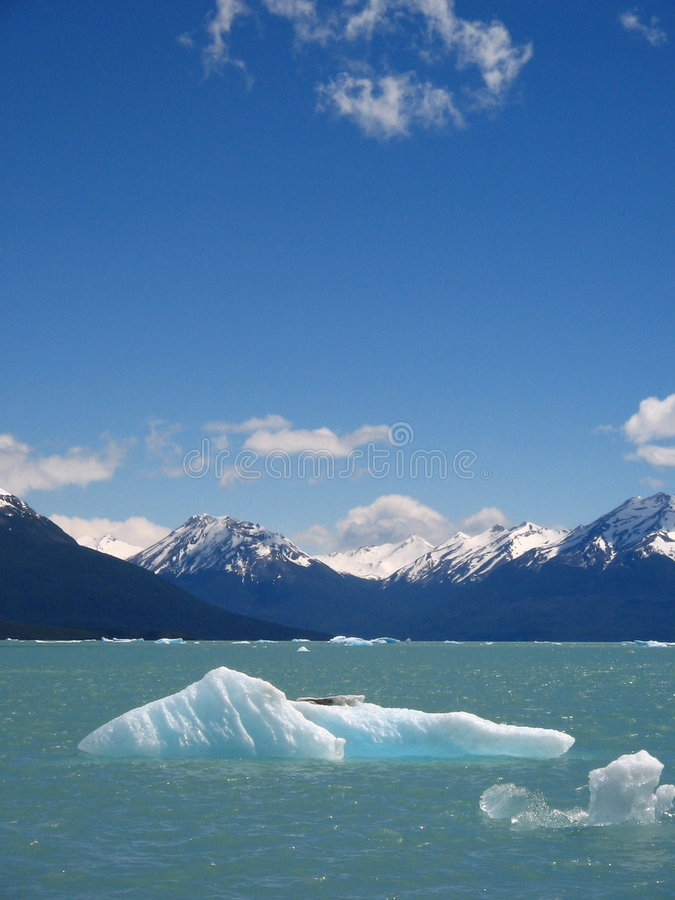Download Iceberg Floating In Front Of Mountains Royalty Free Stock Image - Image: 1706626