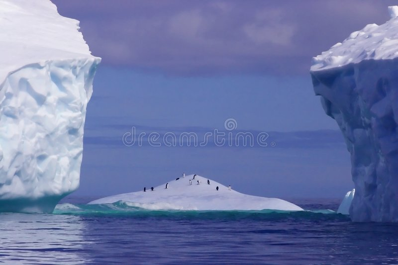 Iceberg between icebergs stock images