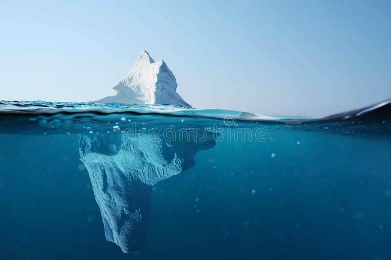 Iceberg in the ocean with a view under water. Crystal clear water. Hidden Danger And Global Warming Concept. royalty free stock image