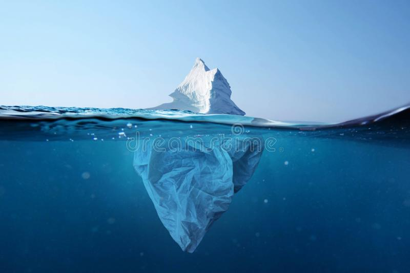Iceberg - plastic bag with a view under the water. Pollution of the oceans. Plastic bag environment pollution with iceberg. Iceberg - plastic bag with a view stock photos