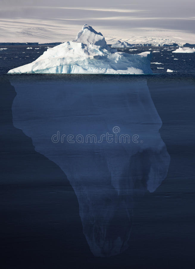 Iceberg showing 90 percent underwater - Antarctica royalty free stock photos