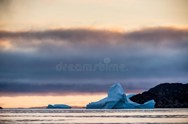 Iceberg at sunset in the Disco Bay, Greenland. stock photo