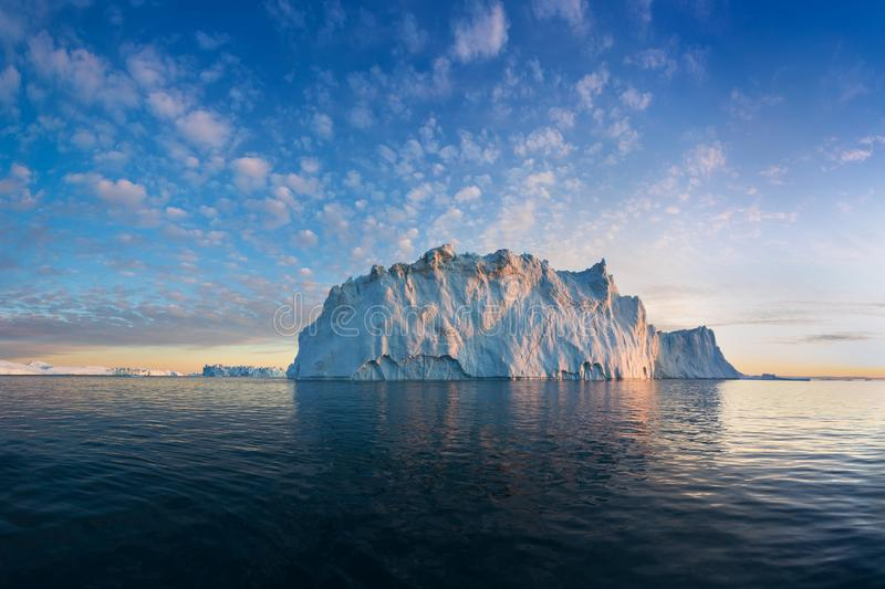 Iceberg at sunset. Nature and landscapes of Greenland. Disko bay. West Greenland. Summer Midnight Sun and icebergs. Big blue ice royalty free stock image