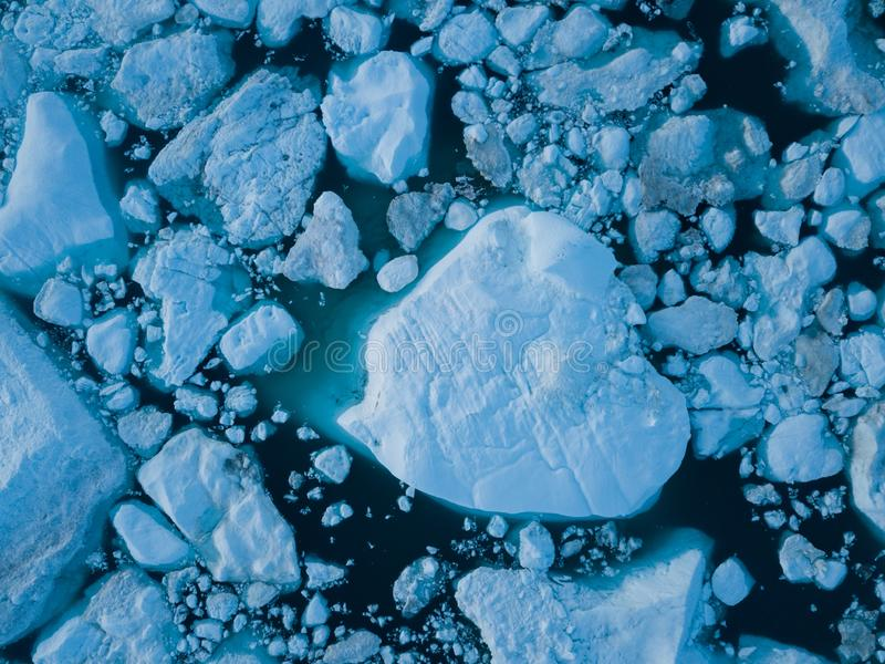 Icebergs drone aerial image top view - Climate Change and Global Warming. Icebergs from melting glacier in icefjord in Ilulissat. Icebergs drone aerial image royalty free stock images