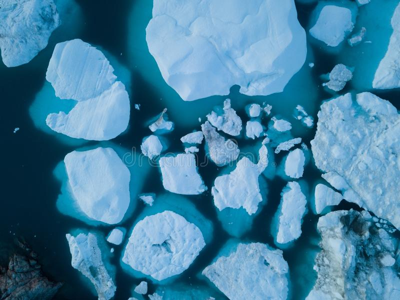 Icebergs drone aerial image top view - Climate Change and Global Warming. Icebergs from melting glacier in icefjord in Ilulissat. Icebergs drone aerial image stock photos