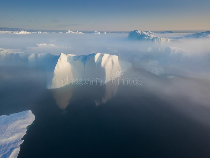Icebergs drone aerial image top view - Climate Change and Global Warming. Icebergs from melting glacier in icefjord in Ilulissat. royalty free stock photos