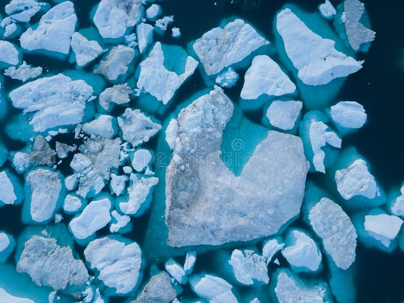 Icebergs drone aerial image top view - Climate Change and Global Warming. Icebergs from melting glacier in icefjord in Ilulissat. Icebergs drone aerial image royalty free stock photography