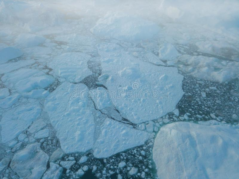 Icebergs drone aerial image top view - Climate Change and Global Warming. Icebergs from melting glacier in icefjord in Ilulissat. royalty free stock photography