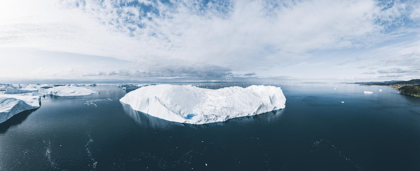 Icebergs drone aerial image top view - Climate Change and Global Warming. Icebergs from melting glacier in icefjord in royalty free stock photography
