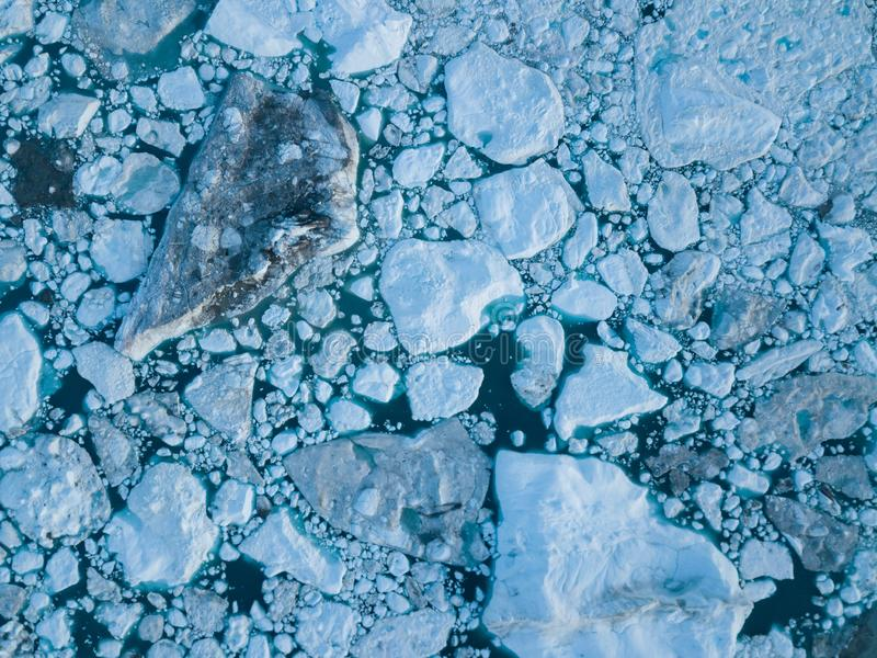 Icebergs drone aerial image top view - Climate Change and Global Warming. Icebergs from melting glacier in icefjord in Ilulissat. Icebergs drone aerial image royalty free stock image