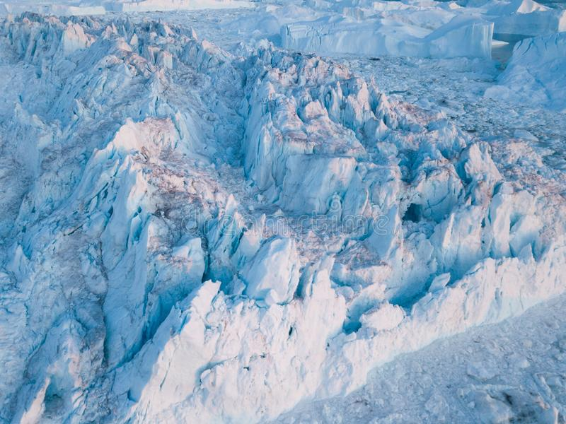Icebergs drone aerial image top view - Climate Change and Global Warming. Icebergs from melting glacier in icefjord in Ilulissat. Icebergs drone aerial image royalty free stock photo