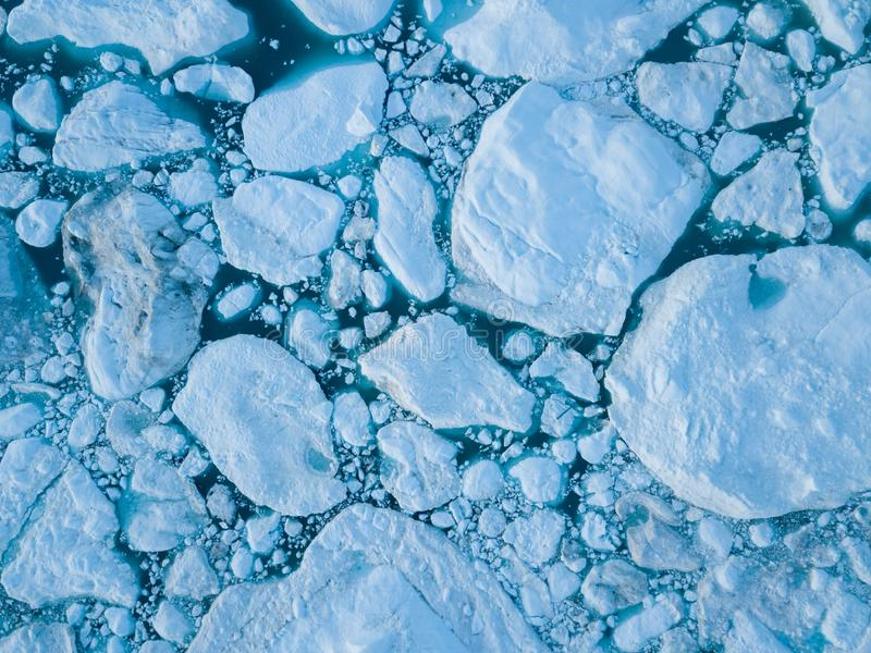 Icebergs drone aerial image top view - Climate Change and Global Warming. Icebergs from melting glacier in icefjord in Ilulissat. Icebergs drone aerial image royalty free stock photos
