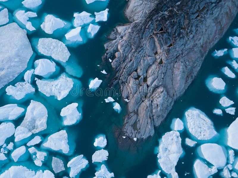 Icebergs drone aerial image top view - Climate Change and Global Warming. Icebergs from melting glacier in icefjord in Ilulissat. Icebergs drone aerial image stock images