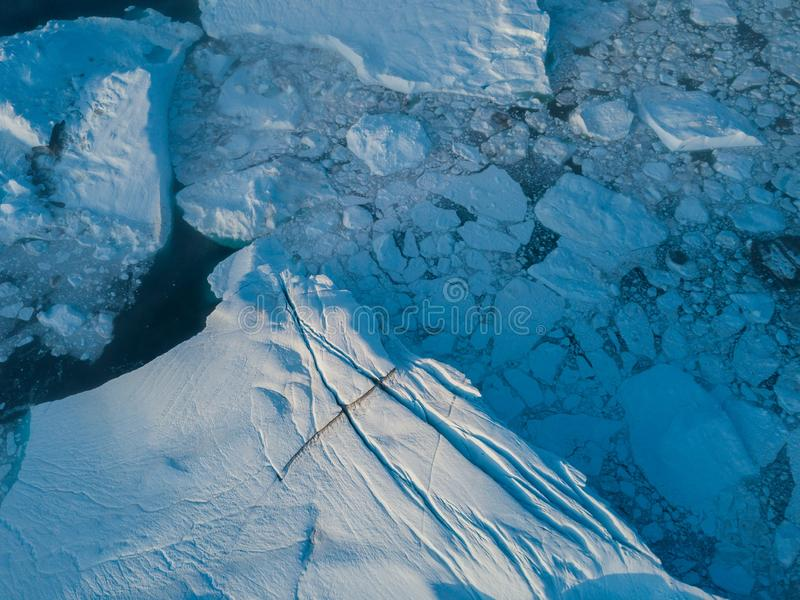 Icebergs drone aerial image top view - Climate Change and Global Warming. Icebergs from melting glacier in icefjord in Ilulissat. stock photos