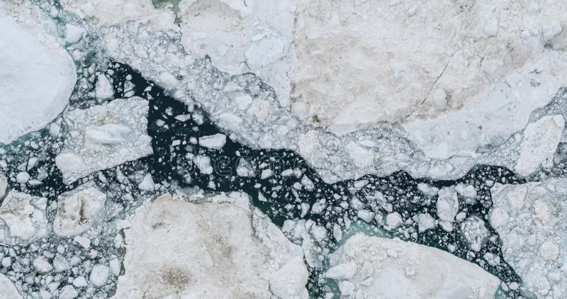 Icebergs drone aerial photo top view - Climate Change and Global Warming royalty free stock photography