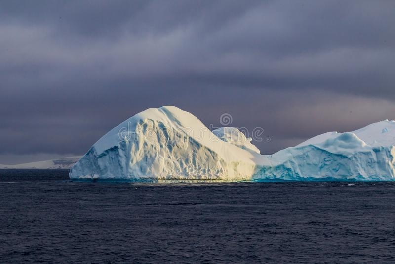 Icebergs float dangerously near Antarctica royalty free stock photos