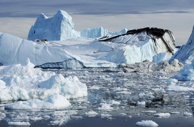 Icebergs in Greenland. Drifting icebergs in the bay of Ilulissat, Greenland stock image
