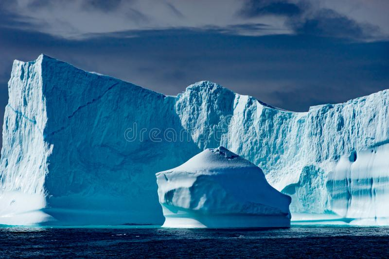Icebergs in Greenland. Huge Iceberg buildings with tower. Beautiful turquoise and blue icebergs near Ilulissat, Disko Bay, Greenland stock image
