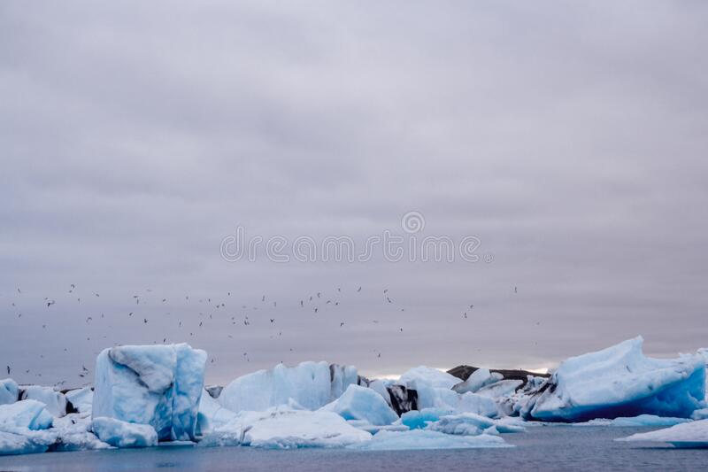 Icebergs in Jokulsarlon lagoon beneath Breidamerkurjokull glacier Sudhurland, Iceland. Place for text or advertising.  royalty free stock image