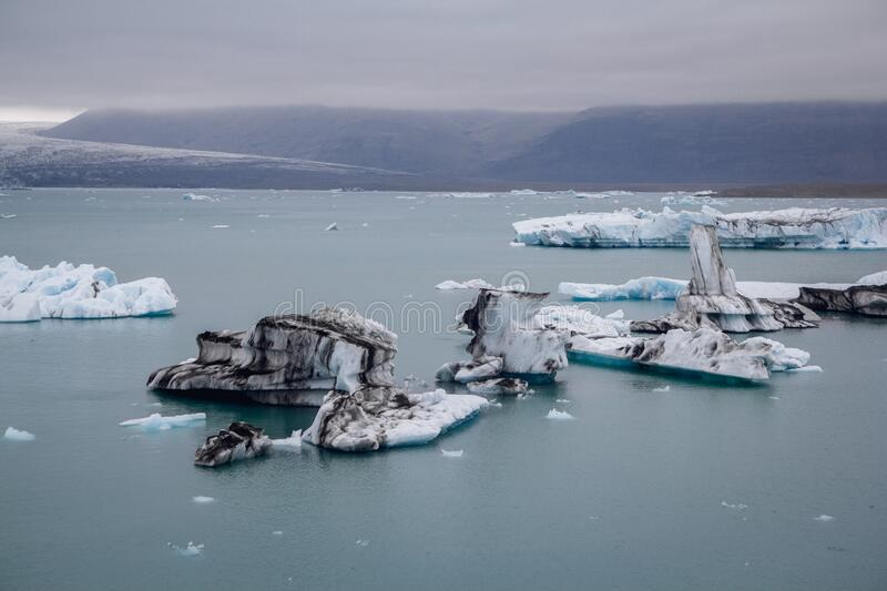 Icebergs in Jokulsarlon lagoon beneath Breidamerkurjokull glacier Sudhurland, Iceland. Place for text or advertising.  royalty free stock images
