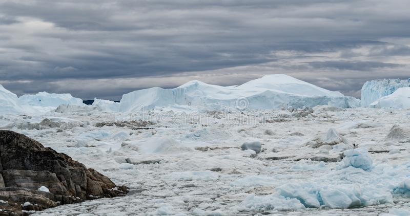 Icebergs from melting glacier in icefjord - Global Warming and Climate Change royalty free stock photo