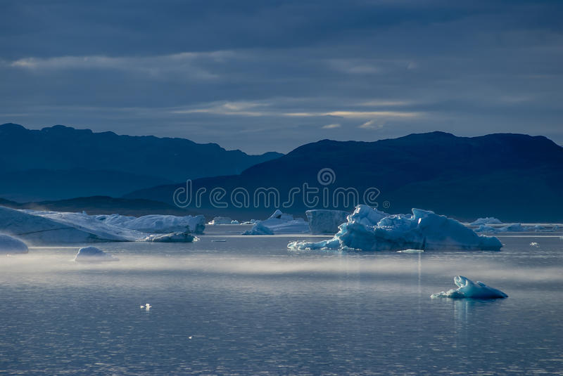 Icebergs in Narsuaq. At sunset stock images