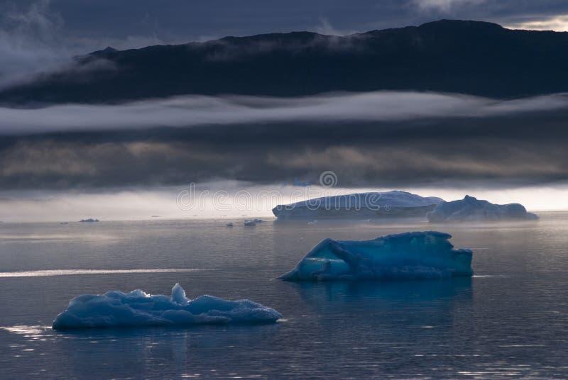 Icebergs in Narsuaq. At sunset stock image