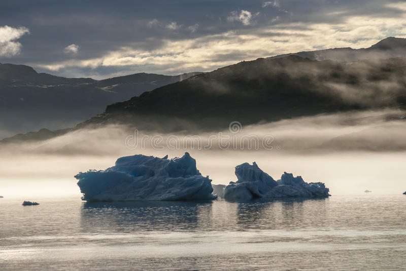 Icebergs in Narsuaq. At sunset stock photography