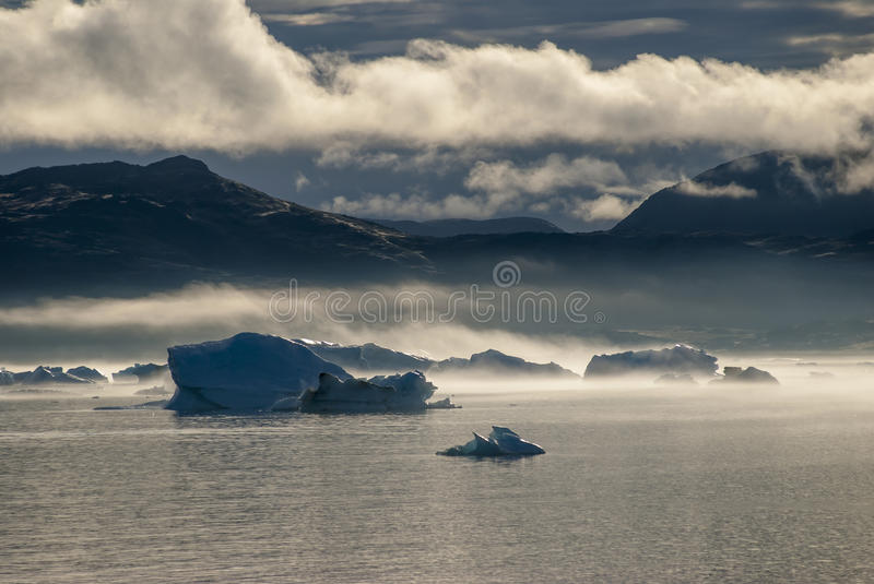 Icebergs in Narsuaq. At sunset royalty free stock image
