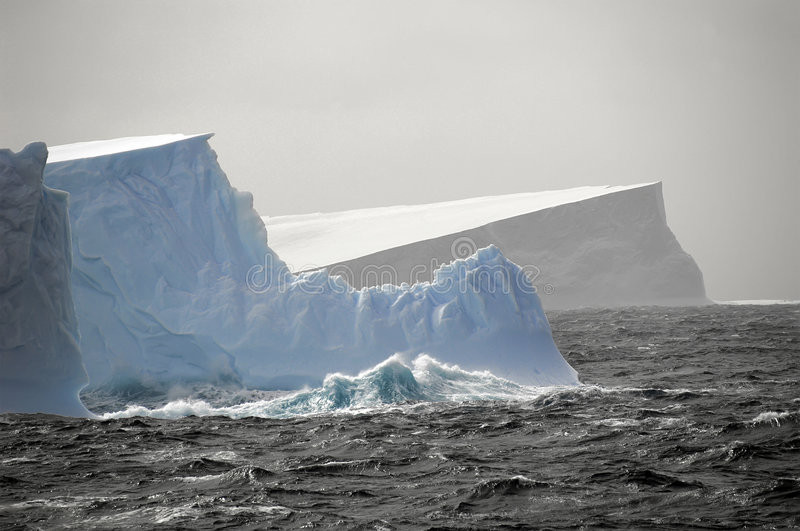 Icebergs in rough waters royalty free stock image
