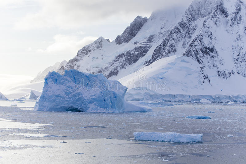 Icebergs and Western Antarctic Peninsula. Icebergs at Lemaire Channel, Western Antarctic Peninsula royalty free stock photo