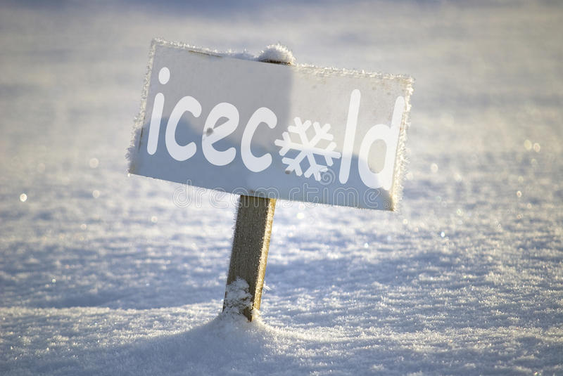 Icecold signboard. Signboard with text icecold, in the winter scene royalty free stock photo