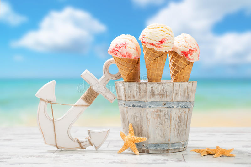 Icecream At The Beach. Raspberry ripple icecream at the beach with anchor and starfish royalty free stock photo