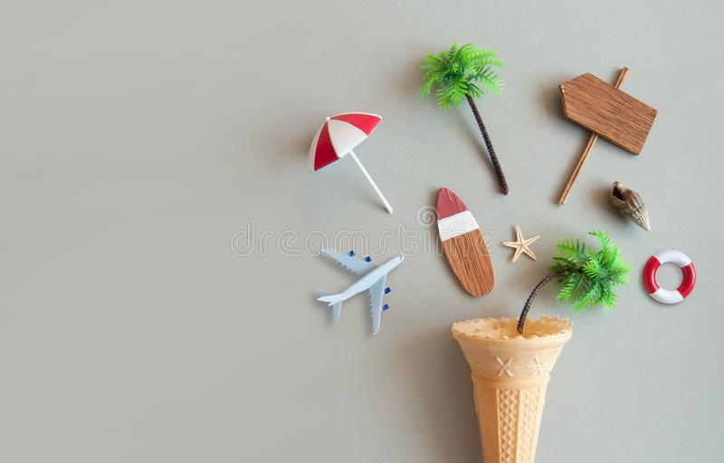 Icecream cone summer background. Icecream cone with various summer items including parasol, surfboard, miniature airplane and pine trees stock images