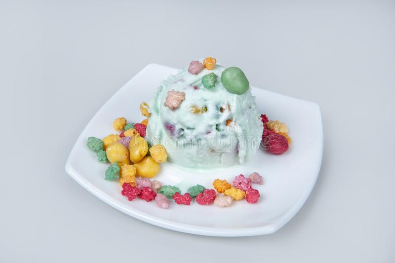 Icecream With Fruits. Icecream with different ingredients on a studio neutral background royalty free stock images