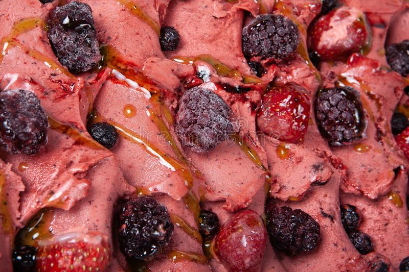 Icecream With Fruits. Icecream with different ingredients on a studio neutral background stock photo