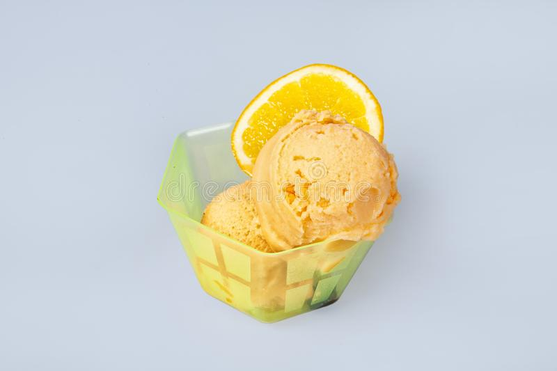 Icecream With Fruits. Icecream with different ingredients on a studio neutral background royalty free stock photos