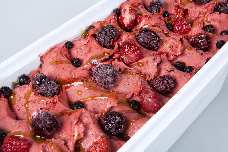 Icecream With Fruits. Icecream with different ingredients on a studio neutral background stock image
