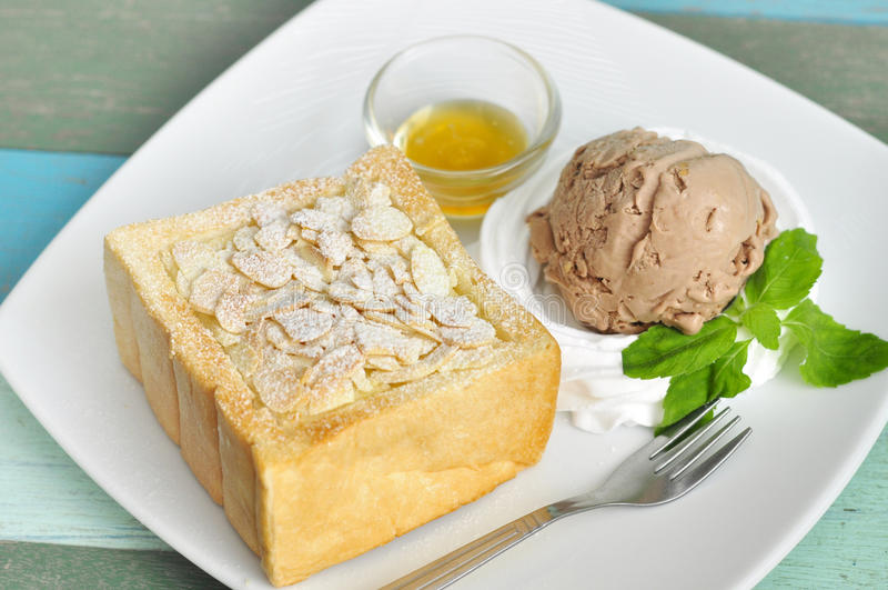 Icecream on toast. Chocolate icecream on buttered toast royalty free stock photography