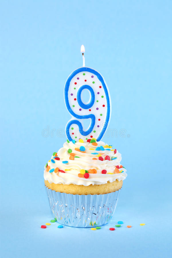 Iced Birthday Cupcake With With Lit Number 9 Candle Stock