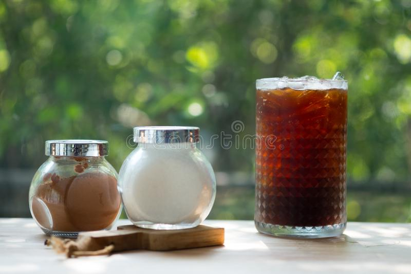 Iced black coffee with sugar and brown sugar in glass bottle royalty free stock photo