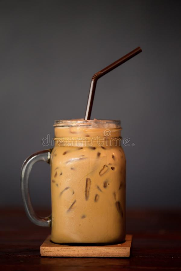 Iced Coffee in cup glass Vertical shot in Studio. Vertical shot stock photography